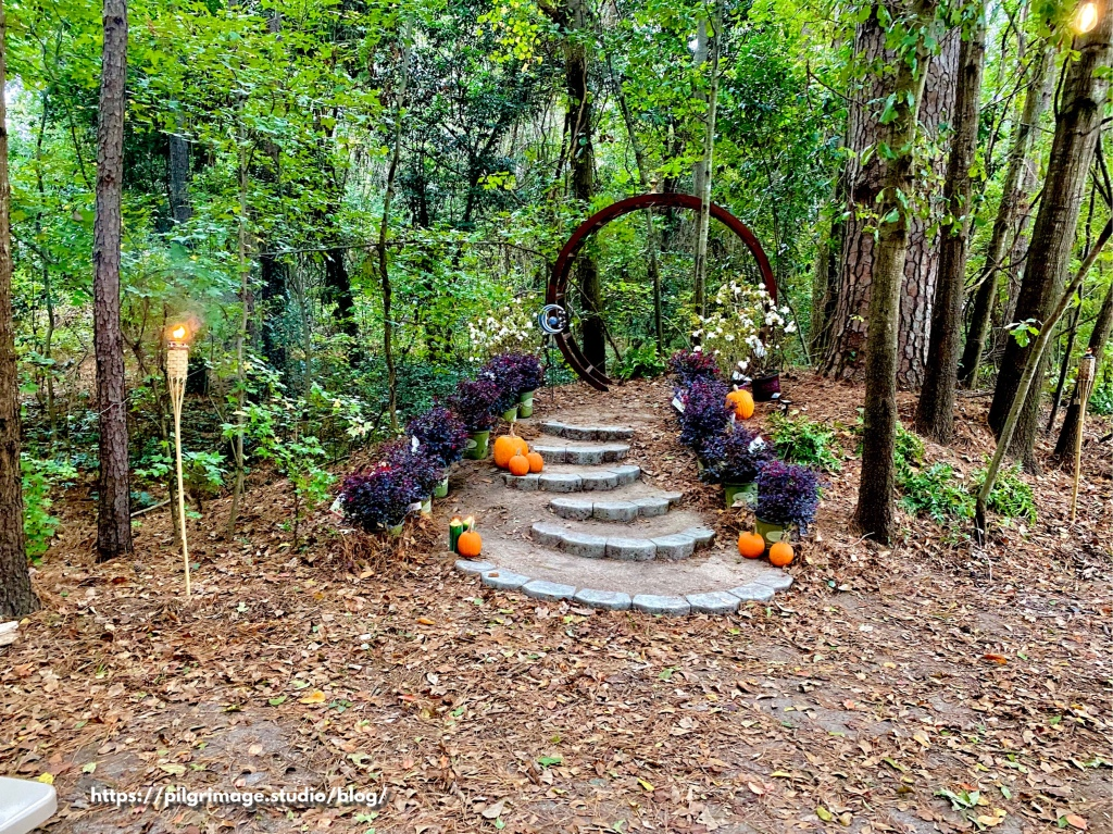 Stone steps with pumpkins leading up to the archway